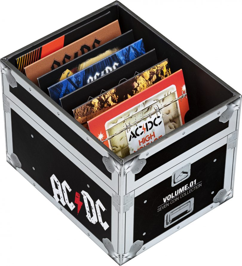 Packaging for seven-coin collection of AC/DC coins.
