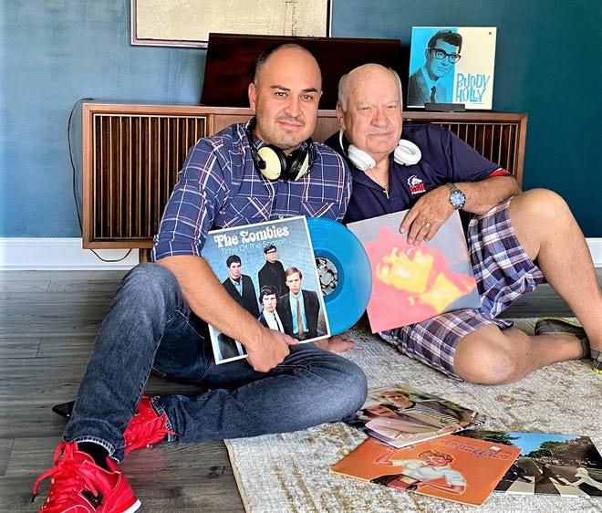 Dalton, left, and Bob Sprouse, with a few of the records that served as bonding material through the years.