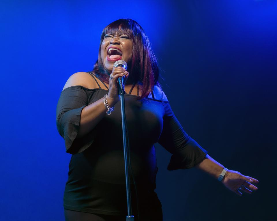Shemekia Copeland on stage in a black dress