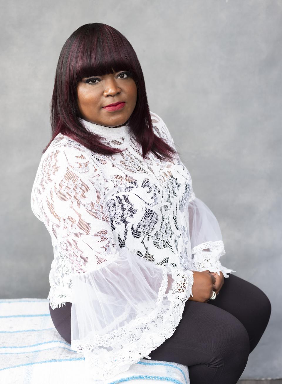 Shemekia Copeland sitting in white lace blouse